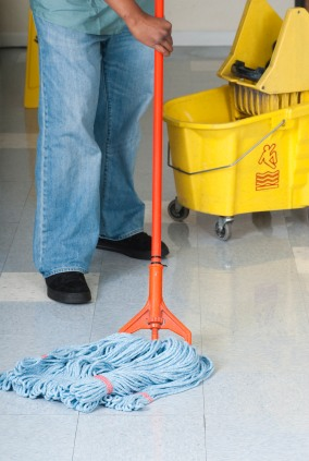 Baza Services LLC janitor in Palmerdale AL mopping floor.